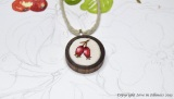 embroidered rosehip pendant