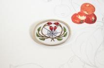 Rosehip and web brooch